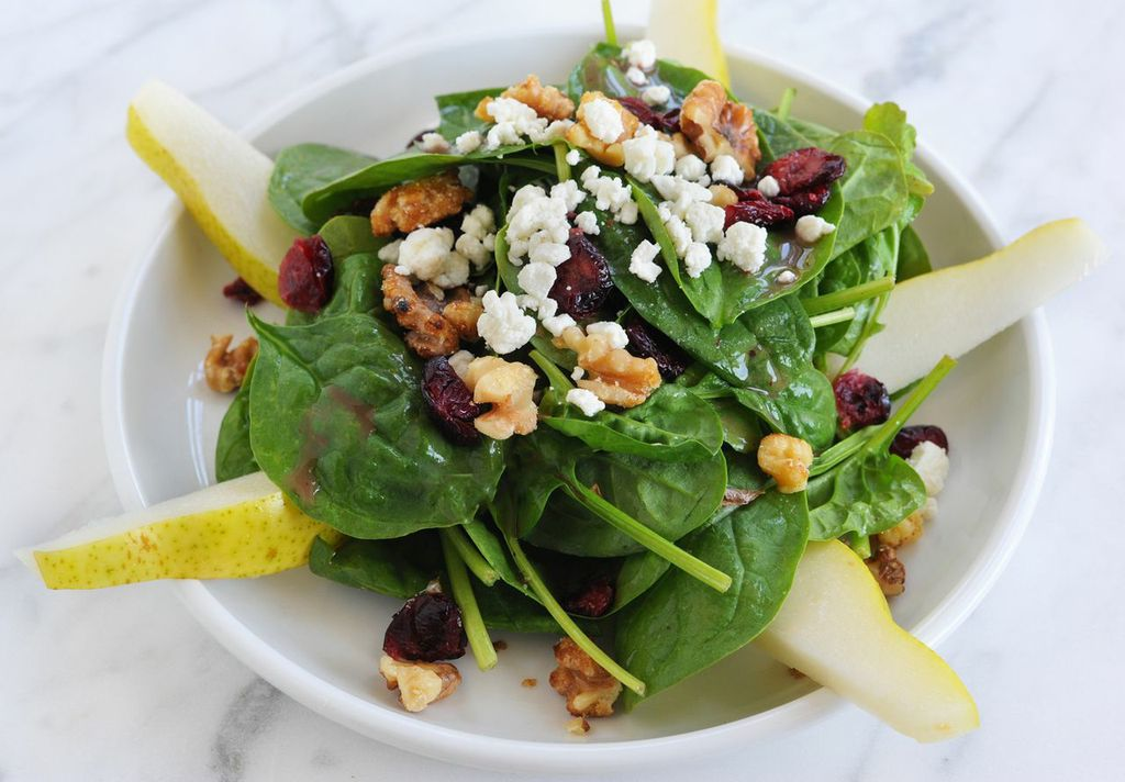 spinach-salad-with-cranberries-candied-walnuts-pears-and-goat-cheese-tossed-with-raspberry-vinaigrette