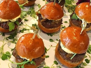 mini-beef-sliders-angus-beef-roasted-garlic-basil-aioli-sweet-caramelized-onions-organic-baby-arugula-brioche-bun