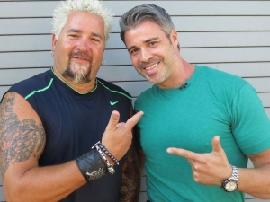 Marcel with Guy Fieri on Guys Grocery Games on the Food Network